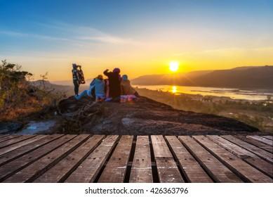 Wooden floor and sunrise on the top of SuPha Taem National Park, Ubonratchathani, Thailand