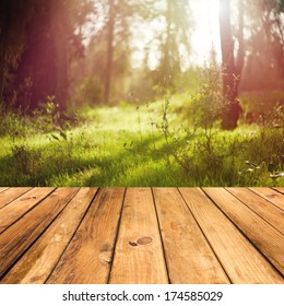 Wooden floor terrace over forest background