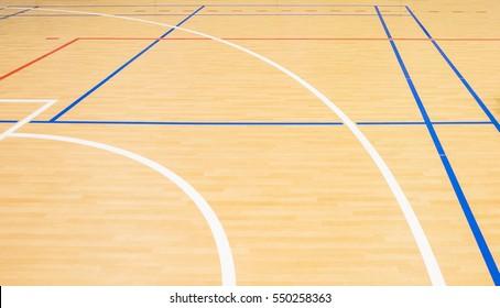 wooden floor volleyball, basketball, badminton court with light effect Wooden floor of sports hall with marking lines line on wooden floor indoor, gym court