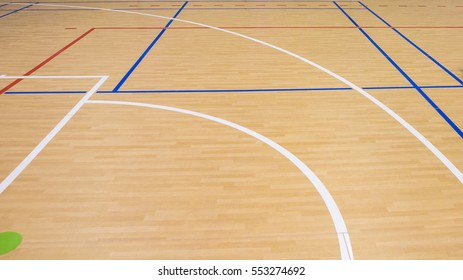 wooden floor volleyball, basketball, badminton court with light effect Wooden floor of sports hall with marking lines line on wooden floor indoor, gym court