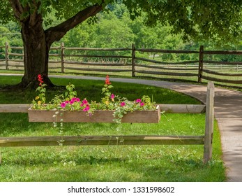 A wooden flower box in Park in New Jersey on a nice Summer day.