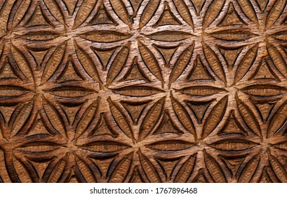 wooden flower of life sign texture background