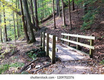 Wooden foot bridge at Robert Treman State Park in New York at the beginning of fall