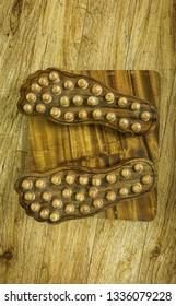 Wooden foot massage, thai massage.