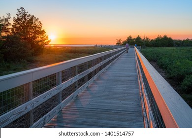 A wooden footbrdge at dusk in the Sandy Hook National Recreation Area along the Jersey shore.