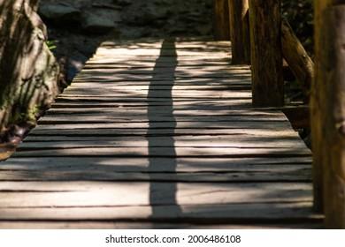 wooden footbridge across the river on a walking trail