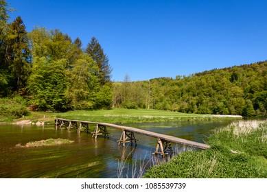 Wooden footbridge across Semois river in Cugnon (Bertrix), Luxembourg province, Ardennes region, Wallonia, Belgium.