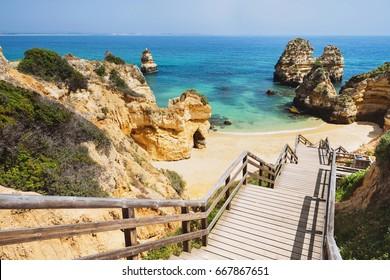 Wooden footbridge to beautiful beach Praia do Camilo near Lagos in aAlgarve region, Portugal