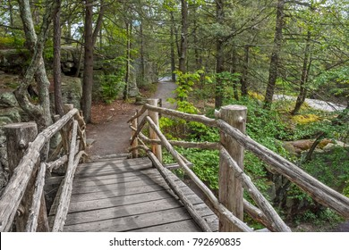 A wooden footbridge on a hiking trail of Minnewaska State Park Preserve in New York state.