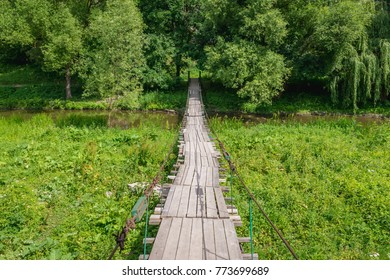 Wooden footbridge over Smotrych River canyon in Kamianets Podilskyi, Ukraine
