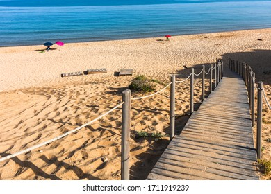 Wooden footpath to the beach in Sardinia