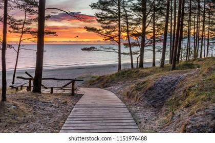 Wooden footpath leading to a shore of the Baltic Sea, Jurmala, Latvia
