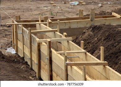 Wooden formwork concrete strip foundation for a cottage