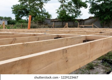 Wooden frame house construction. Wooden flooring base under construction.