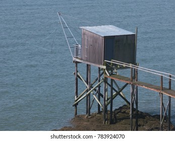 Wooden frame with huts and fishing gear on the French Atlantic coast