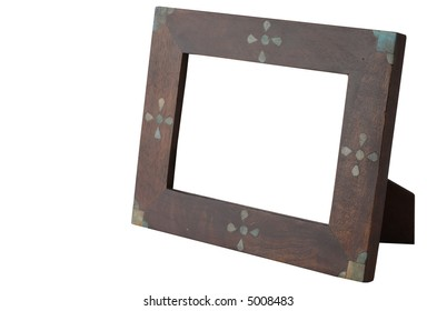 Wooden frame isolated and hollow on white. Includes clipping path.