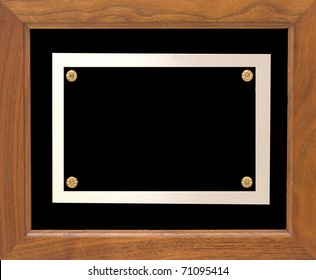 A wooden frame with a metal plate which could hold information showing an award.