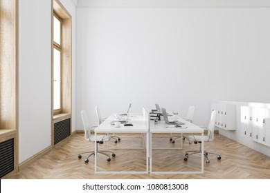Wooden frame office interior with white walls, a wooden floor and rows of computer desks. A side view. 3d rendering mock up