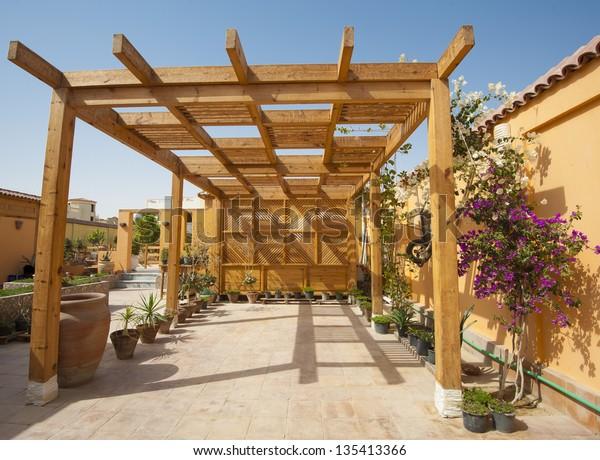 Wooden frame parking area garage at a tropical villa property