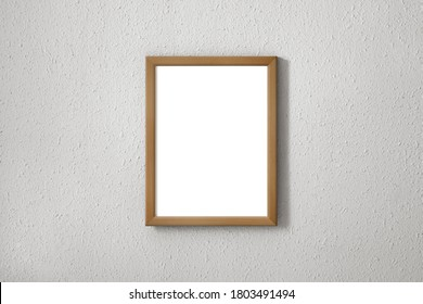 Wooden frame with white background on a textured wall. 2d photomontage