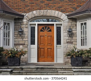 wooden front door with stone steps
