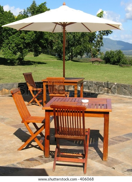 Wooden furniture covered by umbrella