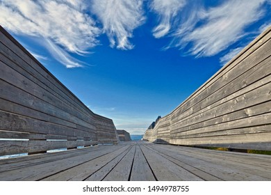A wooden gangway leading to the beach on the island of Senja, Norway
