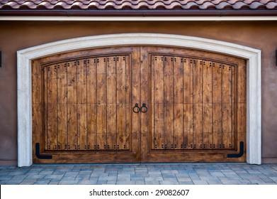 Wooden garage doors on an upscale California home