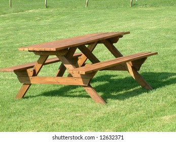 Wooden Garden Bench on neat lawn