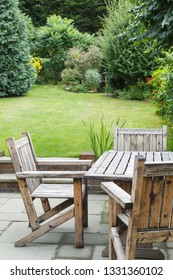 Wooden garden furniture table and chairs on a patio