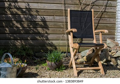 wooden gardenchair in secluded garden