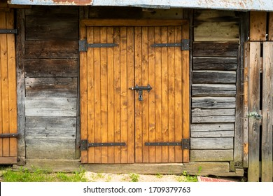 wooden gate with a bolt lock in an old farm shed