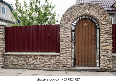 Wooden gate in brick arch
