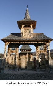 Wooden gate carved with traditional models