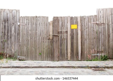 Wooden gate at a cobbled street/Wooden Fence and Gateway