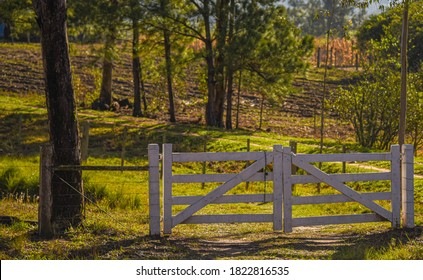 Wooden gate. Entrance of rural property in southern Brazil. Area of agricultural production and small areas of agricultural exploitation. Interior. Non-urban area.