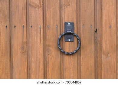 wooden gate with handle and keyhole closeup