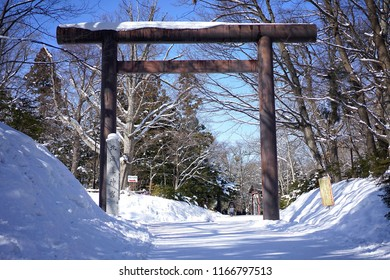 The wooden gate in maruyama park that is on the way to go to Hokkaido shrine in Japan