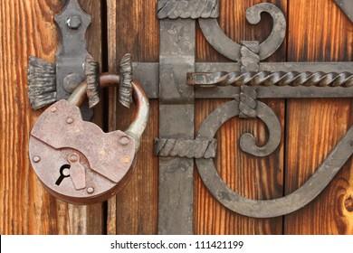 wooden gate old padlock on a wooden door