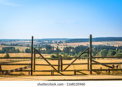 Wooden gate at a ranch in a beautiful rural landscape