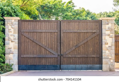 Wooden Gates With Stone Columns The Design Is Vintage Style