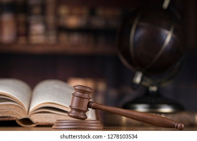 Wooden gavel and books, Law, globe concept