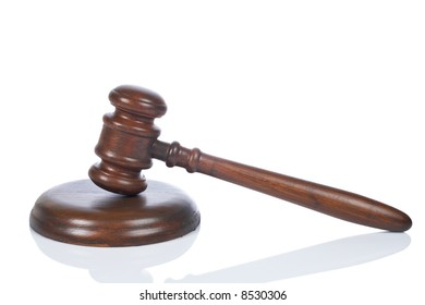 Wooden gavel from the court reflected on white background