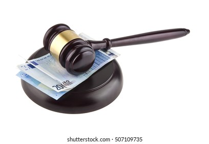 wooden gavel and European banknotes isolated on white background closeup