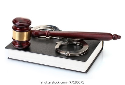 wooden gavel, handcuffs and book isolated on white