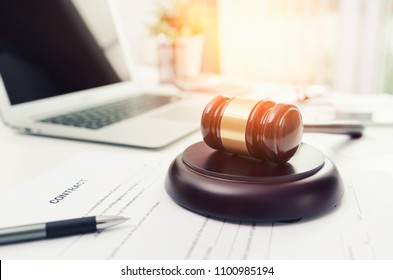 Wooden gavel at lawyer or attorney office. Online, law, technology, justice concept