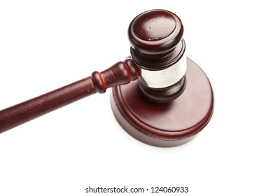 Wooden gavel is lying against white background
