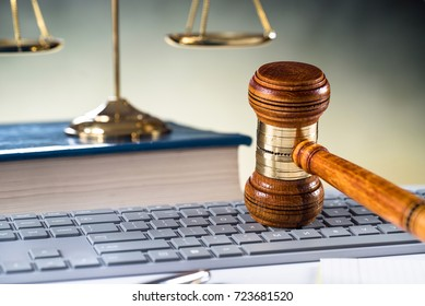 Wooden gavel on laptop keyboard. auction, online, law, technology, justice concept  kluczowych: English