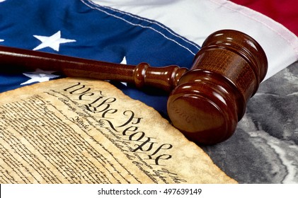 Wooden gavel on top of American flag and Bill of Rights document