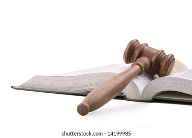 Wooden gavel and open textbook.  Isolated on white.